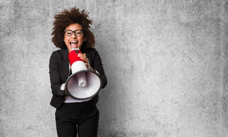 Manager tries to motivate sales team by yelling into a megaphone about incentive programs.