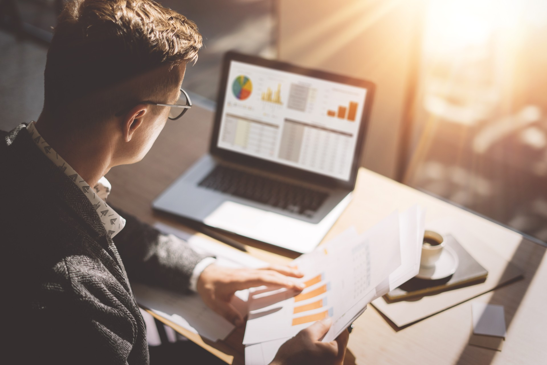 Finance manager looks over commission calculation reports and analytics