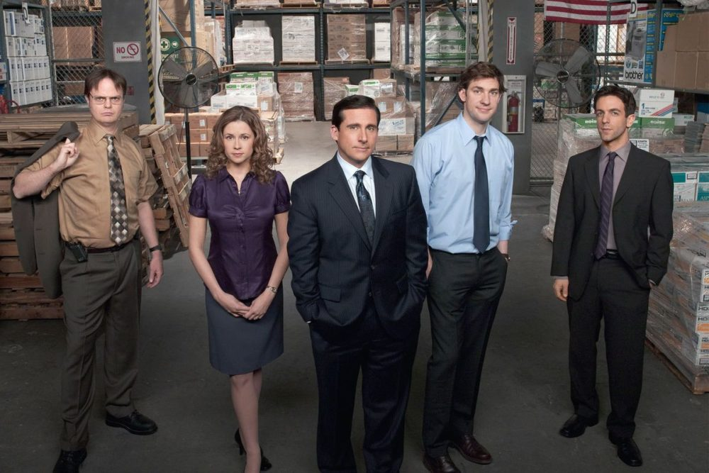 The sales team at Dunder Mifflin on the Office stands in the warehouse between earning commission selling paper.