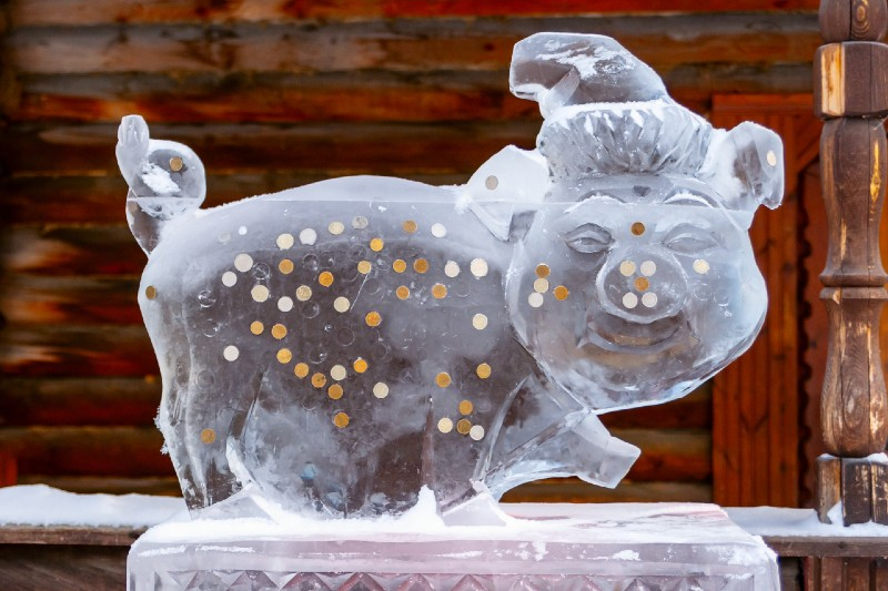Ice sculpture of a piggie bank that someone could learn to make with all the time they'll save with sales commission management software.