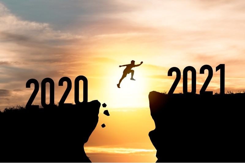 Person jumps from 2020 cliff to 2021 across a chasm as we end 2020 and take a look back at our best stories of the year.