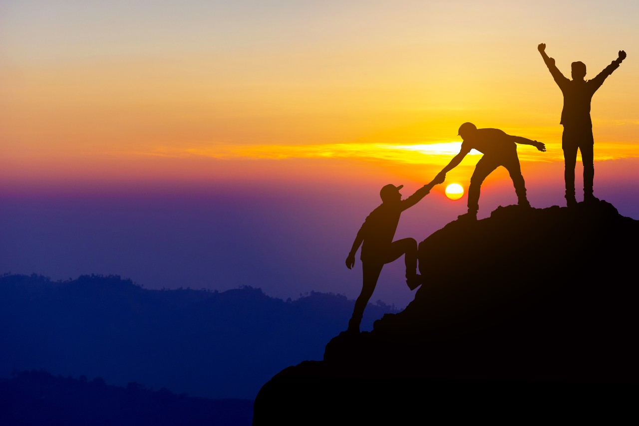 Climbers help each other reach the top of a mountain the way that senior employees who reach sales commission ceilings might help colleagues.