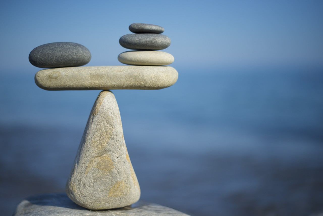 Stacked rocks balance like a scale the same way Core Commissions can balance commission management.